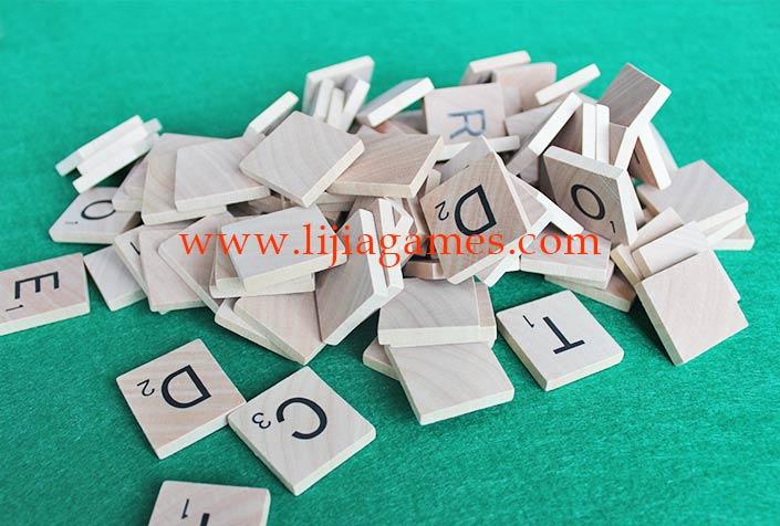 wooden scrabble tiles game pieces