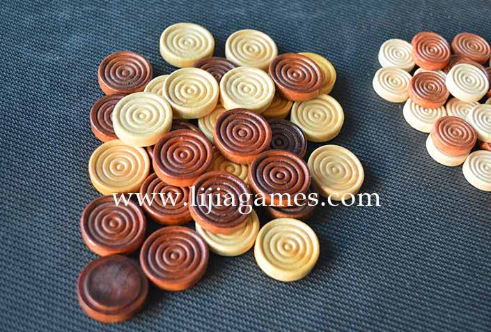 wooden draughts pieces